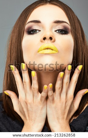 Beauty woman face portrait with yellow lips and nails. - stock photo
