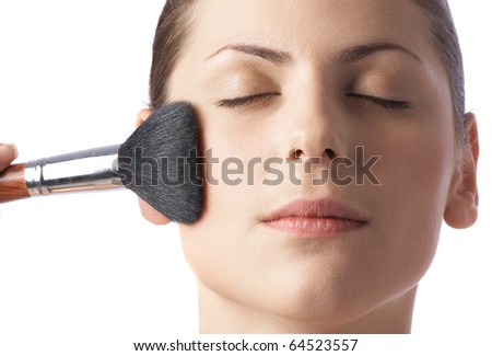 Beauty woman face with brush against white background