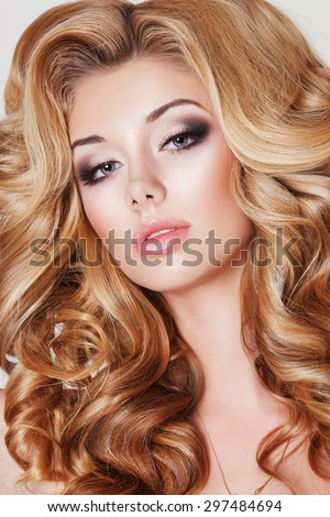 Beauty woman fashion blonde girl with long curly hair vogue style model, blond female with bright makeup and hairstyle. Fashionable blonde girl fashion studio photo, isolated, series