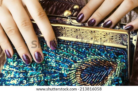 beauty woman fingers with manicure holding luxury bag - stock photo