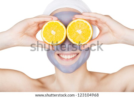 Beauty woman getting facial mask  with orange isolated on white background - stock photo