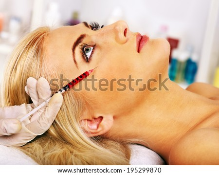Beauty woman giving injections. - stock photo