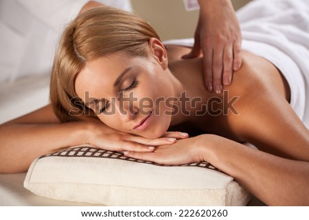 Beauty woman having relaxation massage in wellness center - stock photo