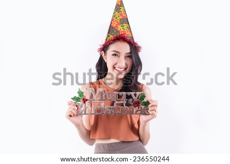 Beauty woman holding Christmas sign. Christmas woman portrait of a cute, beautiful smiling mixed Asian model. Isolated on white background.  - stock photo