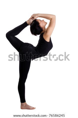 beauty woman in black stand in yoga Dancer Pose - stock photo