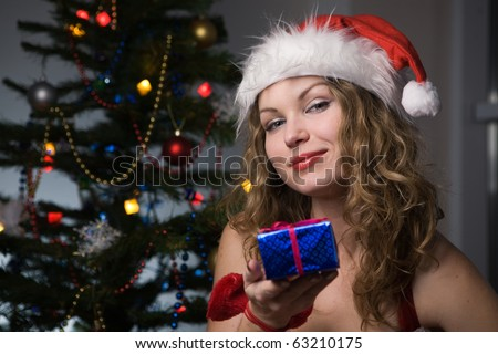 beauty woman in santa hat with christmas tree