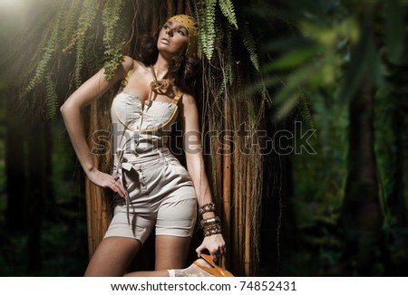 Beauty woman in the tropical forest - stock photo
