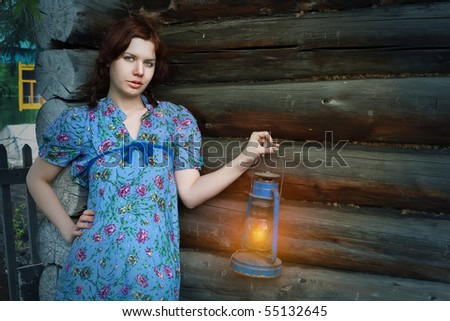 beauty woman in vintage dress on wooden background