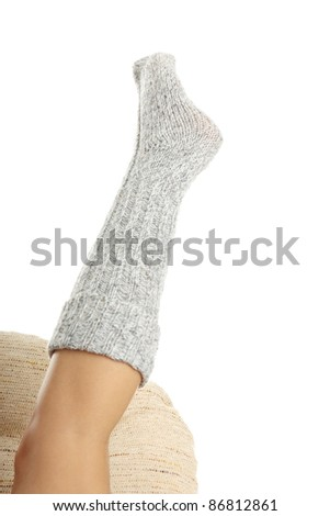 Beauty woman leg in sock isolated on white background