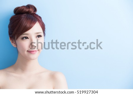 beauty woman look somewhere isolated on bluebackground, asian