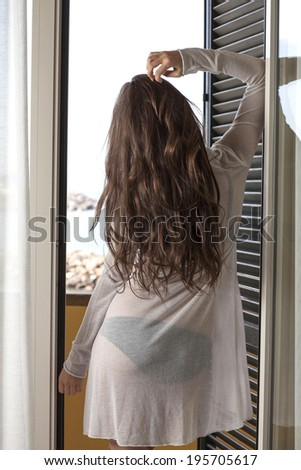 Beauty woman looking out window