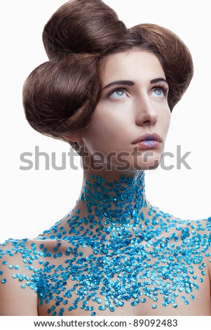 Beauty woman makeup with crystals on neck on white background - stock photo