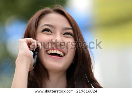 Beauty woman on phone laughing smile and looking up  - stock photo
