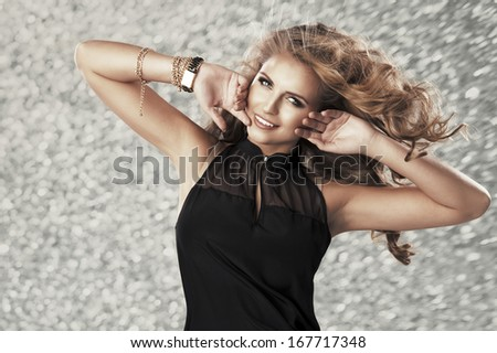 Beauty woman on silver background  - stock photo
