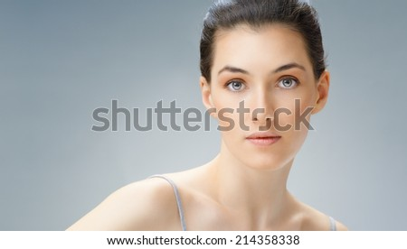 beauty woman on the blue background - stock photo