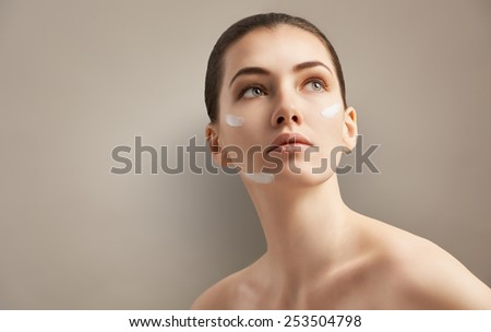beauty woman on the grey background - stock photo