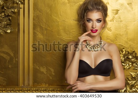 Beauty woman over gold background  - stock photo