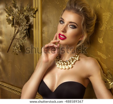 Beauty woman over gold background