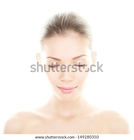Beauty woman - perfect skin care portrait. Female beauty spa close up of serene relaxed multiracial girl relaxing with eyes closed isolated on white background. Mixed ethnic Asian Chinese / Caucasian. - stock photo