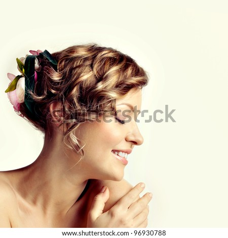 Beauty woman portrait, hairstyle with flowers - stock photo