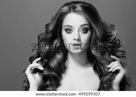 Beauty Woman Portrait. Healthy Long Hair and perfect holiday make up. Black and white photo.