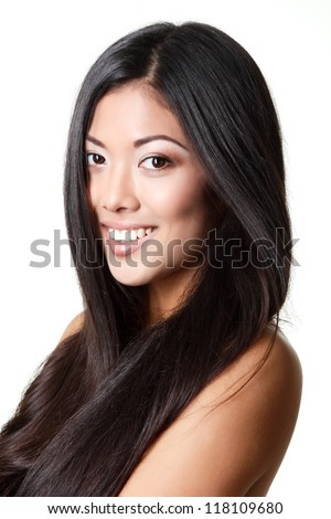 beauty woman portrait of young beautiful smiling girl with long black hair and clean skin over white - stock photo