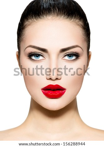 Beauty Woman Portrait. Professional Makeup for Brunette with Blue eyes - Red Lipstick, Smoky Eyes. Beautiful Fashion Model Girl Face. Perfect Skin. Make up. Isolated on a White Background.  - stock photo