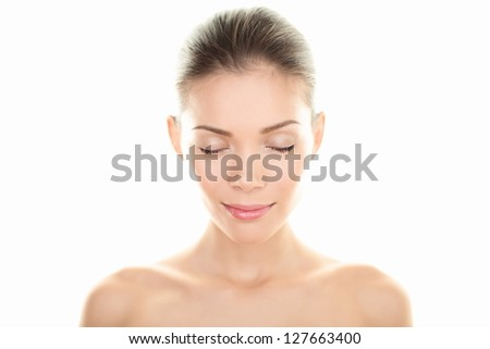 Beauty woman portrait. Skin and face care concept with beautiful serene multiracial woman closing eyes relaxing isolated on white background. Caucasian / Asian Chinese female beauty model relaxed. - stock photo