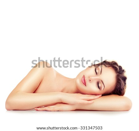 Beauty Woman Relaxing and Lying Down. Spa Girl. Sleeping or Resting Female isolated on White Background. Relax. Relaxation. Beauty Salon