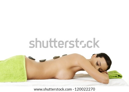 Beauty woman relaxing in spa. Stone massage. - stock photo