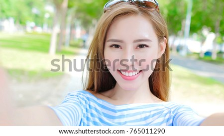 beauty woman selfie happily in the park
