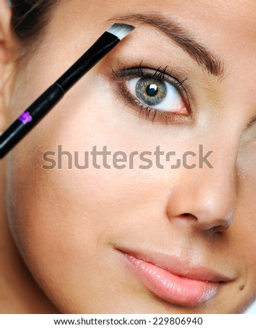 Beauty Woman. Skincare concept. Beauty Face. Beauty concept.Makeup Applying. Professional Make-up.Beauty Fashion Girl Applying eye shadows.