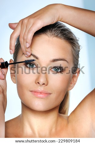 Beauty Woman. Skincare concept. Beauty Face. Beauty concept.Makeup Applying. Professional Make-up.Beauty Fashion Girl Applying mascara. - stock photo