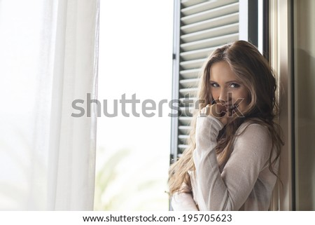 Beauty woman smiling at balcony