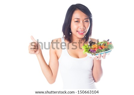 Beauty woman thumb up with vegetables Salad on white background