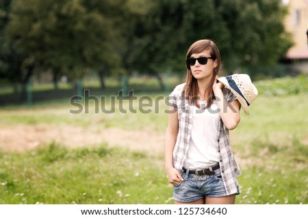 Beauty woman walking through meadow - stock photo