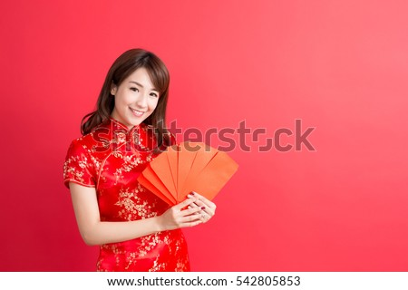 beauty woman wear cheongsam and take Red envelopes in chinese new year