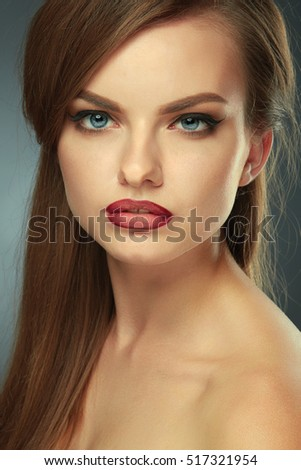 beauty woman with artistic makeup on green gray background