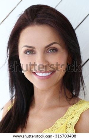 Beauty.  Woman with beautiful face at home