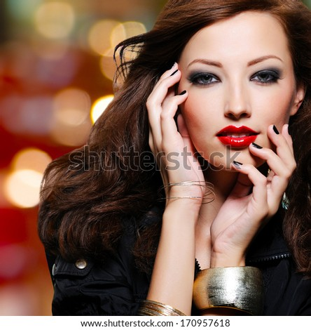 Beauty woman with bright fashion eye makeup and red lips