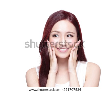 Beauty woman with charming smile and look to something empty copy space, she has health skin, teeth and hair isolated on white background, asian beauty - stock photo