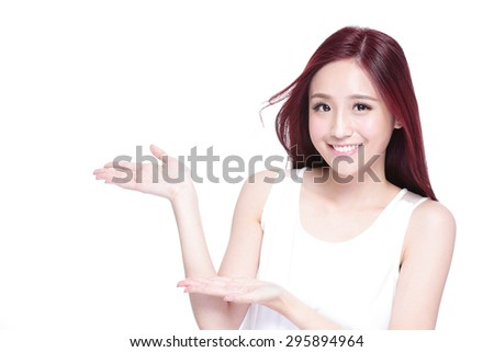 Beauty woman with charming smile and show something to you with health skin, teeth and hair isolated on white background, asian beauty - stock photo