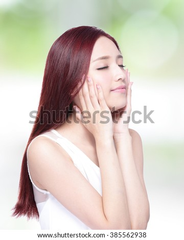 Beauty woman with charming smile enjoy herself with health skin, teeth and hair with nature green background, asian beauty - stock photo