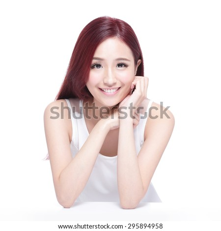 Beauty woman with charming smile to you,  she rests her elbows on white table, she with health skin, teeth and hair, asian beauty - stock photo
