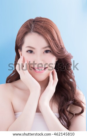 Beauty woman with charming smile to you with isolated blue background, asian