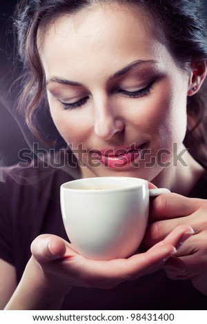 Beauty Woman With Cup of Coffee or Tea - stock photo