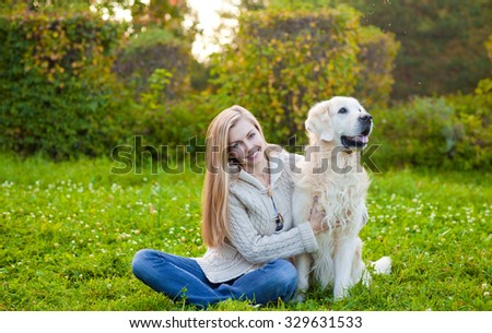Beauty woman with her beautiful dog playing outdoors
