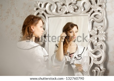 Beauty woman with long hair and mirror