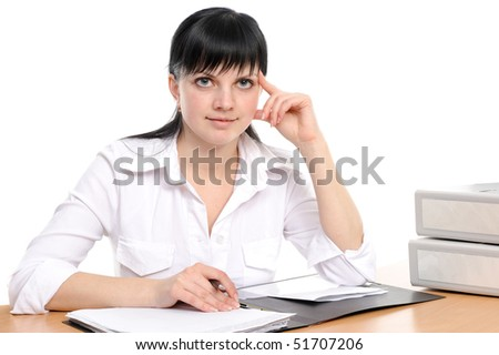 beauty woman with long hair sits at a table with the book and writes