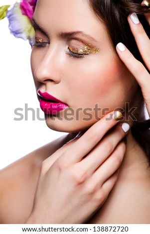 Beauty woman with makeup and closed eyes isolated on white background. Crimson lips and Nails.